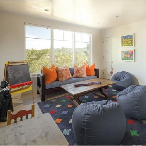 A playroom with blue and orange accents