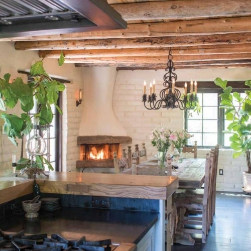 An open, rustic kitchen and dining room