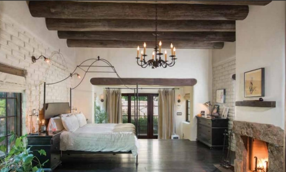 A rustic bedroom and fireplace