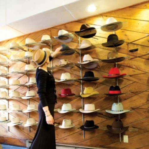 A woman in a hat shop