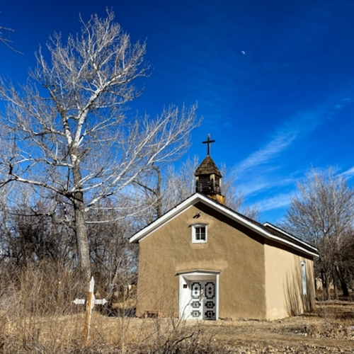 Along the Los Luceros Historic Site's self-guided trail is a restored eighteenth-century chapel.