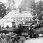 An old image of a children riding in a miniature train