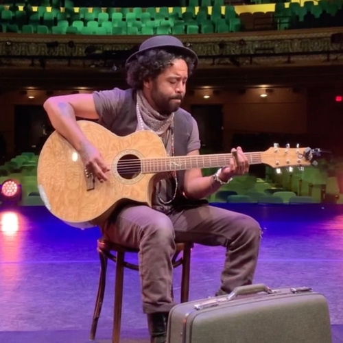 Garry Blackchild plays music at the Lensic Performing Arts Center