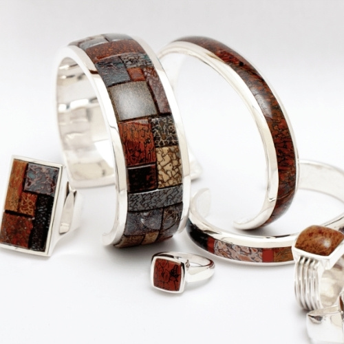 Cuffs and rings by James Kallas Jewelers